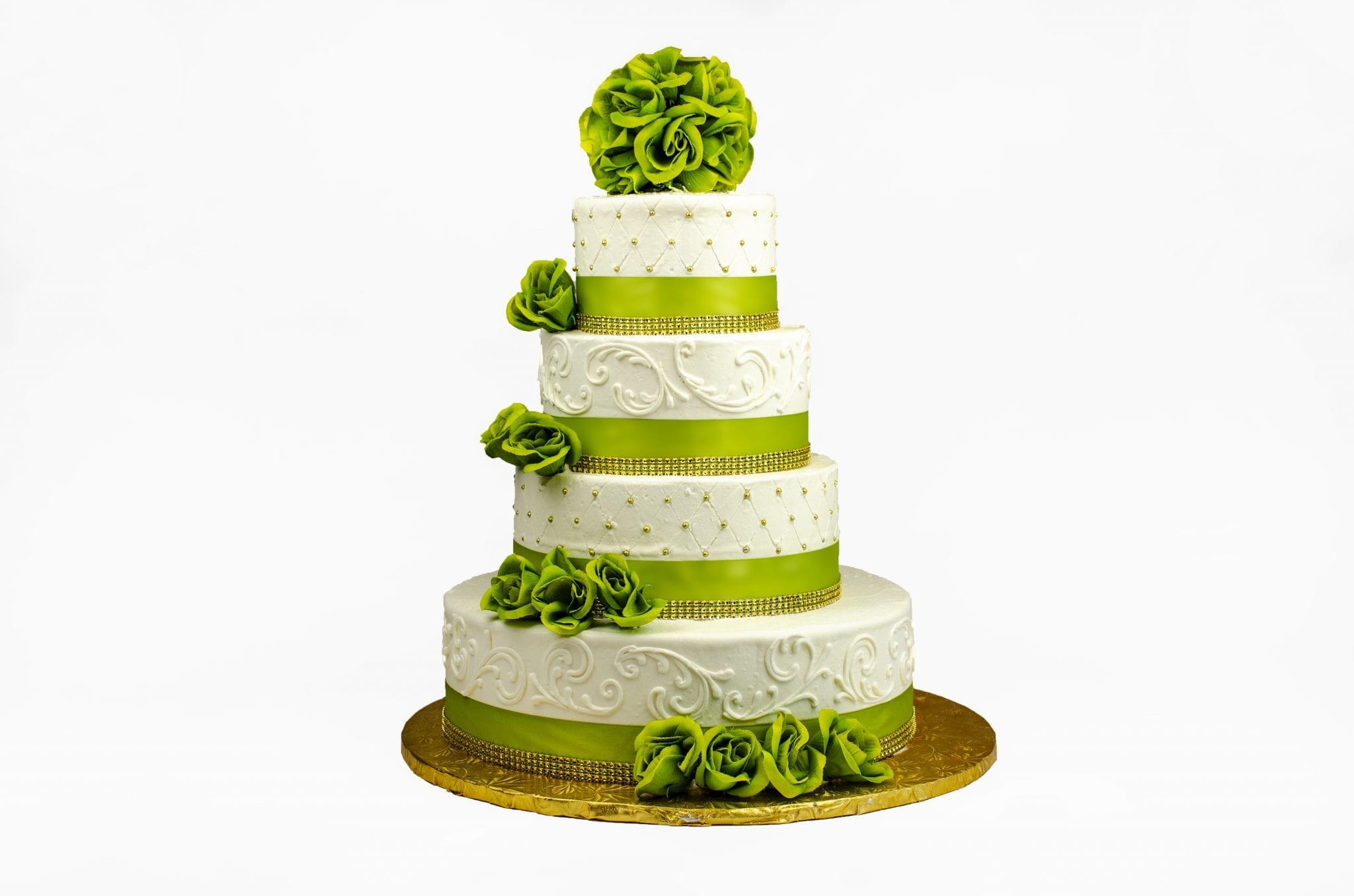 White wedding cake with green ribbons and flowers