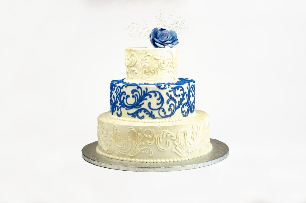 White wedding cake with blue designs